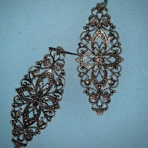 Silver floral design earrings